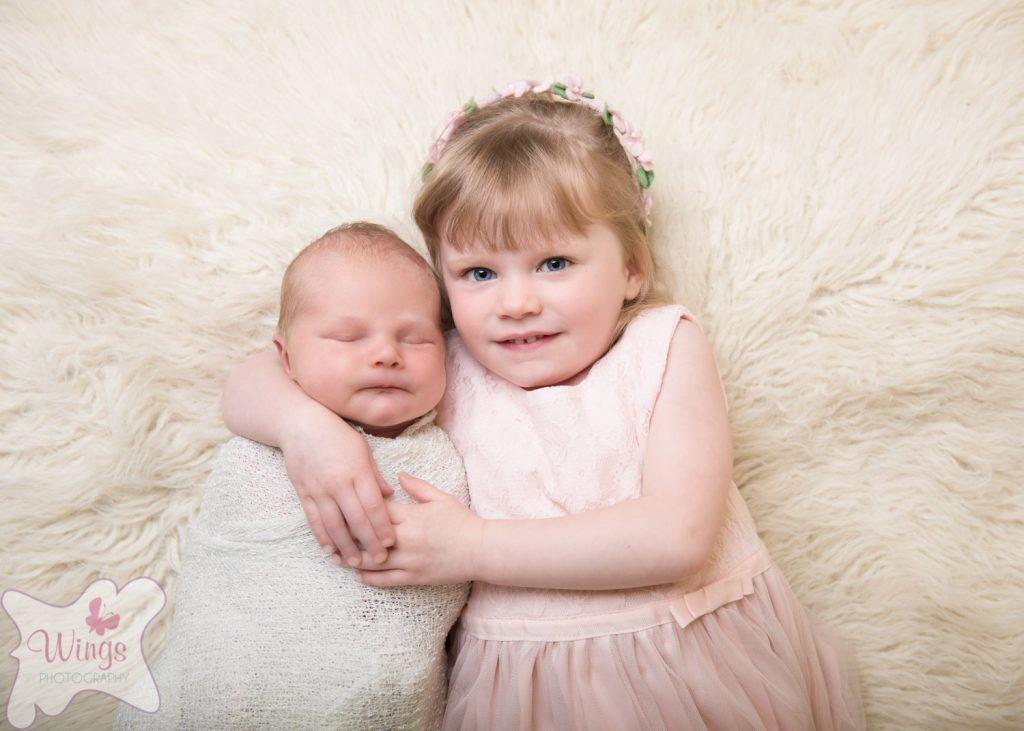 Newborn and siblings