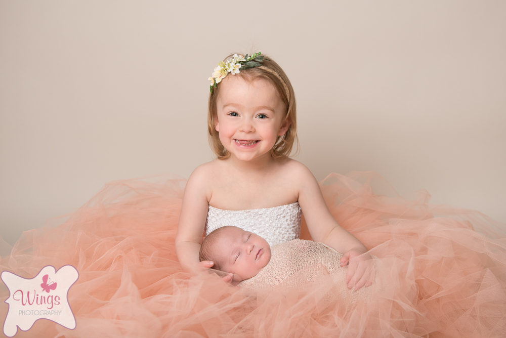 Sibling and newborn safety in the studio